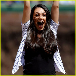 Mila Kunis puts her hands in the air to celebrate after successfully ...  Mila Kunis