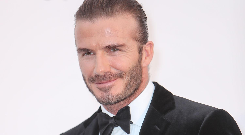 David Beckham Pulls His Hair Back For AmfAR Cannes Gala - David beckham new hairstyle