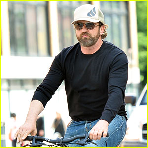 Gerard Butler Enjoys Outdoor Meal & Bike Ride Around NYC