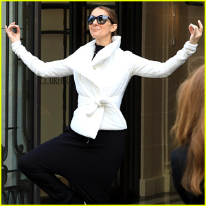 Celine Dion Does Yoga Poses While Exiting Her Paris Hotel