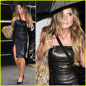 Heidi Klum Braves the Rain in Black Leather Dress & Heels