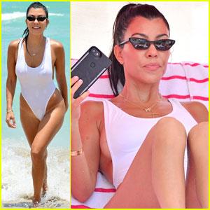 Kourtney Kardashian Shows Off Killer Body in White Swimsuit