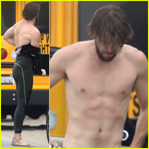 Liam Hemsworth Strips Out of Wetsuit to Reveal Ripped Abs