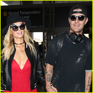 Paris Hilton & Boyfriend Chris Zylka Hold Hands at LAX Airport