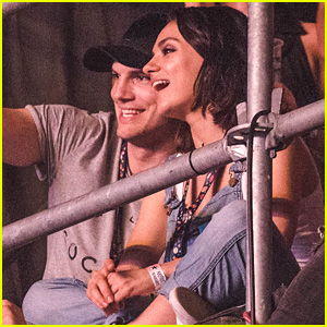 Ashton Kutcher & Mila Kunis Sit on Scaffolding to Watch Wiz Khalifa Perform in Budapest!