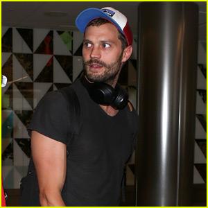 Jamie Dornan Arrives at LAX Airport with His Biceps on Display!