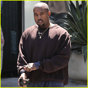 Kanye West Leaves His Office in a Sweatshirt & Jeans