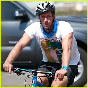 Chris Martin Gives Us a Tricep Flex on His Bike Ride