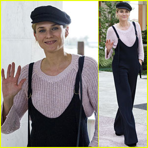 Diane Kruger Smiles in Overalls While Arriving at Venice Airport