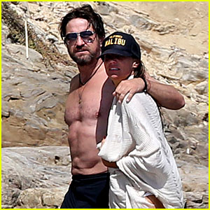 Gerard Butler Goes Shirtless for a Stroll on the Beach with Morgan Brown