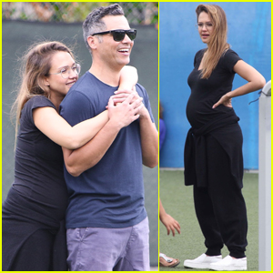 Jessica Alba Cozies Up to Cash Warren While Showing Off Her Baby Bump