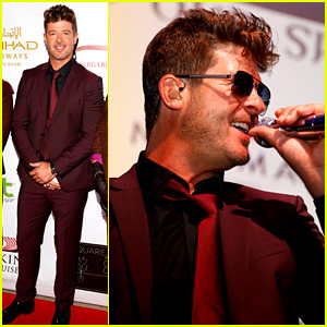 Robin Thicke Performs at Face Forward Gala, Pregnant Girlfriend April Love Geary Watches from Audience