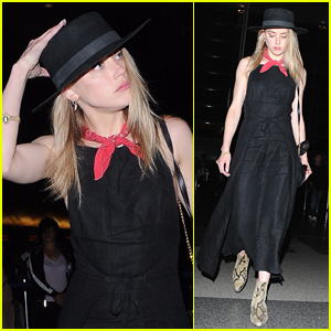 Amber Heard Keeps a Low Profile For Her Flight Out of LAX
