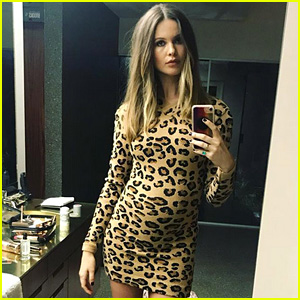Behati Prinsloo Accentuates Baby Bump in Skin Tight Dress!