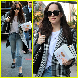 Dakota Johnson Sports Long Plaid Coat While Out in NYC
