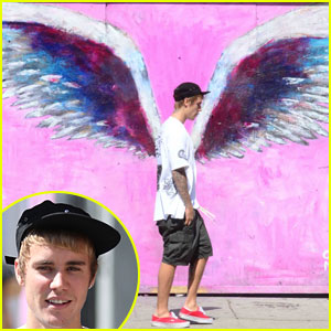 Justin Bieber Walks By Wings Wall Mural at Perfect Time
