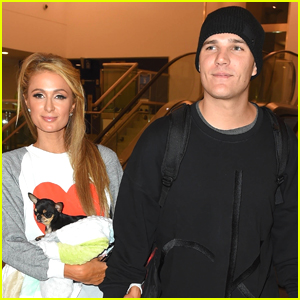 Paris Hilton Carries Her Cute Pup Through LAX Airport