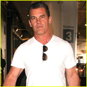 Josh Brolin Flexes His Muscles Flying Into Los Angeles