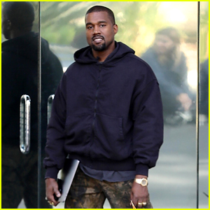 Kanye West Poses & Smiles for Photographers Outside His Office!