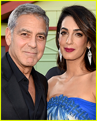 George & Amal Clooney Handed Out Free Headphones to Airline Passengers While Flying with Their Twin Babies