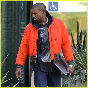 Kanye West Rocks a Tupac Shirt & Bright Orange Jacket at the Studio!