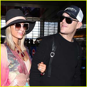 Paris Hilton Cozies Up to Chris Zylka While Jetting Out of LAX