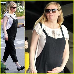 Pregnant Kirsten Dunst Cradles Baby Bump in Overalls