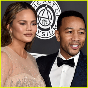 Chrissy Teigen Fires Back At Fan Over Photo of John Legend Carrying Luna