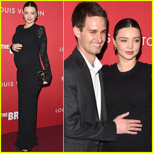 Miranda Kerr's Husband Evan Spiegel Cuddles Her Baby Bump at Louis Vuitton Event!