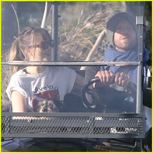 Dakota Johnson & Chris Martin Cruise Around in His Golf Cart