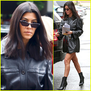 Kourtney Kardashian Shows Off Some Leg in Short, Leather Trench Coat