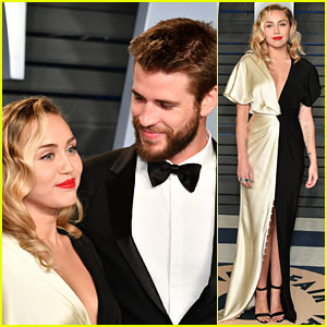 Miley Cyrus & Liam Hemsworth Share Super Sweet Moment at Vanity Fair's Oscars Party