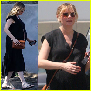 Pregnant Kirsten Dunst Covers Up Baby Bump in Black Dress
