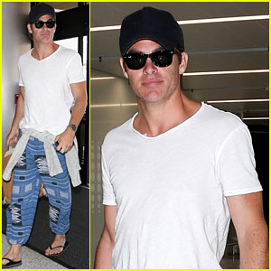 Chris Pine Goes Casual in White Tee & Flip Flops at the Airport