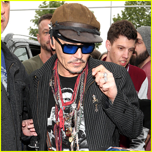 Johnny Depp Greets Fans While Jetting Out of Germany