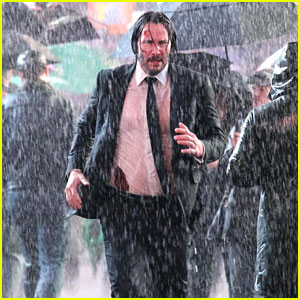 Keanu Reeves Runs Through Rainy Times Square for 'John Wick'