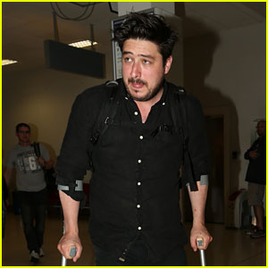 Marcus Mumford Walks With Crutches While Arriving in Scotland for Kit Harington's Wedding