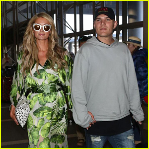 Paris Hilton & Chris Zylka Hold Hands at LAX Airport