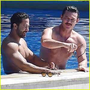 Luke Evans Shows Off His Shirtless Body In the Pool with Victor Turpin