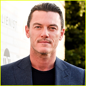 Luke Evans Shows Off His Buff Bod on a Butterfly Float!