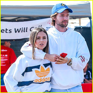 Patrick Schwarzenegger Wraps Arms Around a Friend While Out With Maria Shriver & Christina Schwarzenegger
