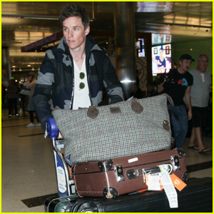 Eddie Redmayne Lands in Los Angeles with Tons of Luggage!