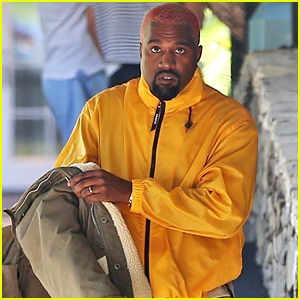 Kanye West Rocks a Bright Yellow Jacket as He Heads Out With Friends in Bel Air