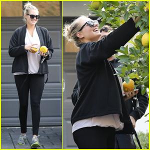 Kate Upton Picks Lemons In Her Yard After A Workout!