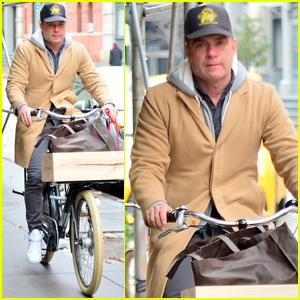 Liev Schreiber Bundles Up For a Bike Ride in New York City!