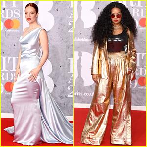 Jess Glynne & H.E.R. Glam Up on BRIT Awards 2019 Red Carpet