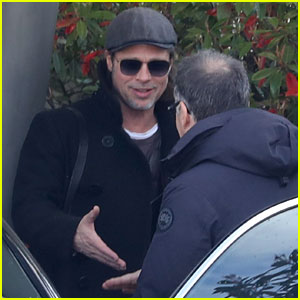 Brad Pitt Flashes a Smile After Arriving in Paris