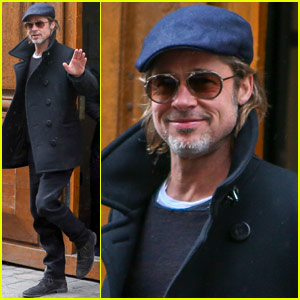 Brad Pitt Waves to Onlookers During Paris Trip