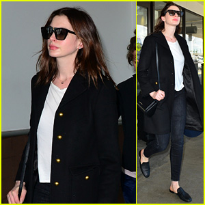 Anne Hathaway Makes a Chic Arrival at LAX Airport