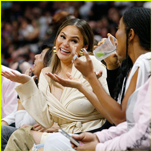 Chrissy Teigen Reacts Immediately After Dwyane Wade Crashes Into Her in These New Photos
